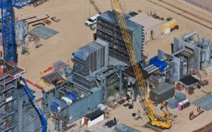Aerial Photography, Turbine and Crane at Natural Gas Generation Plant During Construction.