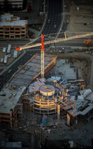 Aerial Photography, JUMP in Downtown Boise Under Construction at Sunrise, With Crane.