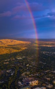 Aerial Photography, East Boise and Boise State Division 1 Football Game at Sunset With Natural Rainbow.