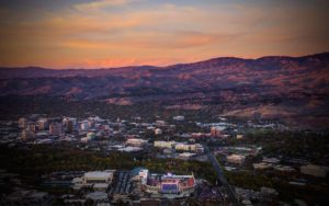 Aerial Photography, Boise State Division 1 Football at Sunset With Downtown Boise and Foothills.