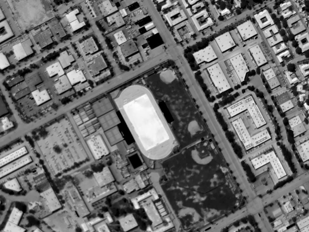 Daytime Aerial Thermograph of John North High School in Riverside, California. Ambient Air Temperature Approximated 105°F; The Apparent Temperature (AT) of the Synthetic Turf is Approximately 180°F; the Adjacent Natural Turf AT is Approximately 95, and the Infield Dirt Approximately 145°F.