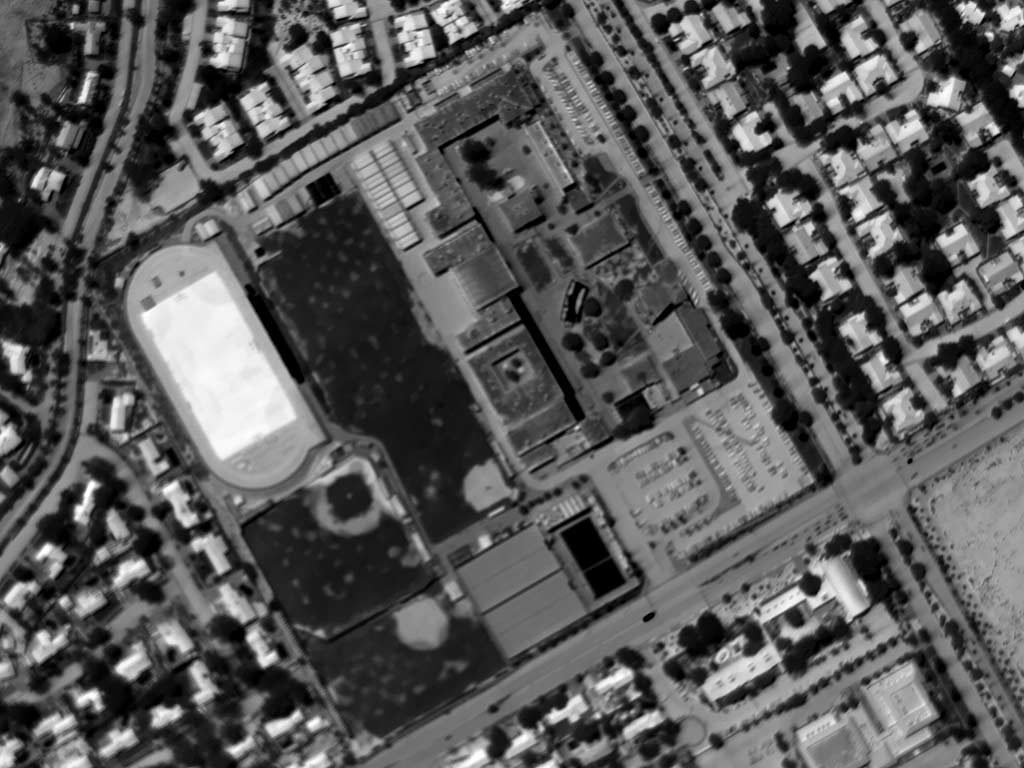 Daytime Aerial Thermograph of Riverside (California) Poly High. The Apparent Temperature of the Synthetic Turf Approximates 180°F.